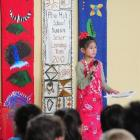 Pine Hill School's Sujata Ritchie (9) explains her banner, which will be displayed at Te Papa...