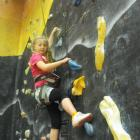 Pippa Bashford (6), of Queenstown, charges up the rock climbing wall. Photos by Olivia Caldwell.