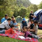 Playing cards at the Trotters Gorge Doc camp site are the Newton family (clockwise, from front...