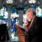 Poet Brian Turner reads to a large congregation in St Paul's Cathedral yesterday at the Otago...