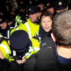 Police and protesters clash outside Government Buildings following the unveiling of the 2013...