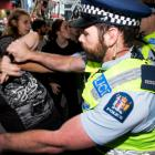 Police and security clash with protesters outside SkyCity during the post-Budget address. Photo...