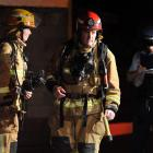 Police and the Fire Service attend a  fire at a Crichton St, Wakari, property last night. Photo...