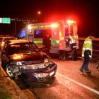 Police at the scene of a car crash on Dunedin's Southern Motorway last night.