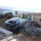 Police, firefighters and medical staff at the scene of a serious crash near Alexandra on Saturday...