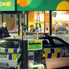 Police investigate after a petrol station was robbed last night. Photo by Stephen Jaqiery.