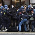 Police make arrests of some of thousands of people demonstrating on the the street in central...