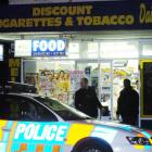 Police make inquiries at the Melbourne Dairy in South Dunedin after it was on Saturday night....
