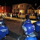Police move to disperse a Castle St crowd. Photo by Craig Baxter.