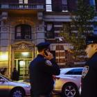 Police officers guard the building where Dr. Craig Spencer lives in New York. Photo by Reuters
