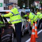 Police officers test motorists at a checkpoint on Great King St last week. Photo by Stephen Jaquiery