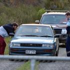 Police speak to the 21-year-old learner driver of a car which was driven on the railway line at...