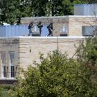 Police SWAT officers surround the Sikh Temple of Wisconsin where at least one gunman stormed the...