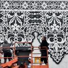 Polish street artist NeSpoon (left) and her husband Martin Rutkiewicz begin their lacework mural...