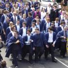 Onlooker Jane Noone (bottom left) photographs Otago Polytechnic certificate in carpentry students...