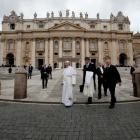 Pope Francis (C) leaves at the end of the general audience in St. Peter's Square at the Vatican....