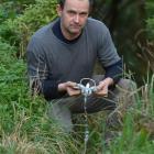 Port Chalmers Community Board deputy chairman Steve Walker holds a gin trap in an area where one...
