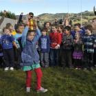 Port Chalmers School pupil Maisy Roberts-Thompson (6) holds aloft a miniature Webb Ellis Cup as...