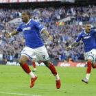 Portsmouth's Fredrique Piquionne, left, celebrates with Kevin Prince Boateng during the FA Cup...