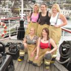 Posing for a charity calendar of Queenstown Volunteer Fire Brigade Firefighters (back, from left)...