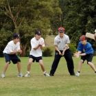 Practising slip catches with sports co-ordinator Michael MacKenzie (right) are John McGlashan...