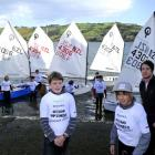 Preparing for a sail at the Ravensbourne Yachting Club are, from left, coach Steven Phillips,...