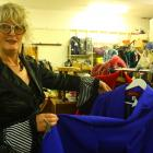 Presbyterian Support Otago retail manager Chrissy Anderson inspects some of the small collection...