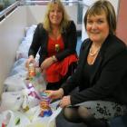 Presbyterian Support Otago social work supervisor Deb Gelling (left) and receptionist...