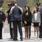 President Barack Obama hugs Diane Wall, wife of Glen James Wall who died at the World Trade...