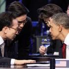 President Barack Obama talks with South Korean President Lee Myung-bak, left, during the opening...