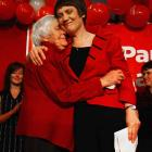 Prime Minister Helen Clark hugs her mother, Margaret, after conceding defeat at the Labour Party...