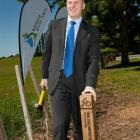 Prime Minister John Key hammers in a post to launch the construction of the New Zealand Cycle...