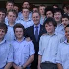 Prime Minister John Key poses with senior pupils from Waitaki Boys' High School during his visit...