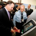 """Prime Minister John Key tries out the new technology """"Smartgate"""" for people travelling between..."""