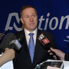 Prime Minister Rt Hon John Key answers questions from media after talking at the National Party...