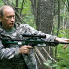 Prime Minister Vladimir Putin holds a tranquilizer gun in a Russian Academy of Sciences reserve...