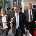 Prime Minster John Key, takes  refreshment on the move in Queenstown yesterday. Photo by James...