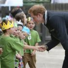 Prince Harry  greets Halfmoon Bay school pupils during his recent visit to Stewart Island. Photo...
