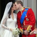 Prince William kisses his wife Kate, Duchess of Cambridge on the balcony of Buckingham Palace. ...