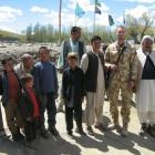 Private Geoff White with Afghan civilians near his base in Bamiyan province. Photo supplied.
