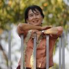 Pro-democracy leader Aung San Suu Kyi smiles at supporters as she celebrates  Burma's  New Year...