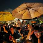 Pro-democracy supporters hold yellow umbrellas, a symbol of the Occupy Central movement, during...