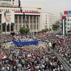 Pro-Syrian government demonstrators hold a rally at Sabe Bahrat Square to commemorate the 65th...
