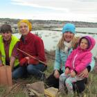 Project co organiser Zuni Steer (left) helps  Oamaru family,  Winsome White, daughter Bron and...