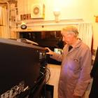 Projectionist Russell Campbell fine-tunes the digital cinema package temporarily installed in the...