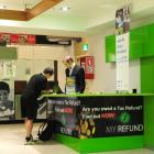 Proposed tax changes could put a dent in tax return businesses flourishing in malls. Photo by...