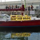 Protest yacht SV Tiama berths with its motor running in Dunedin yesterday. Photo by Stephen...