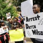 Protesters at the St. Louis County Justice Centre call for the arrest of Police Officer Darren...