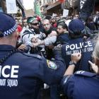 Protesters clash with police on a street in Sydney's central business district last Saturday. ...
