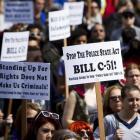 Protesters hold signs during a demonstration last month in Vancouver against Bill C-51, the...
